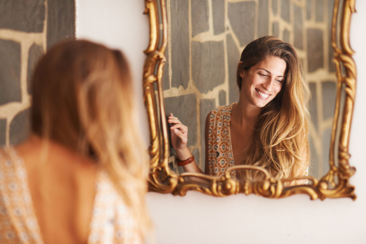 woman reflection self esteem image mirror stocksy main 12 Habits that Change Life, which you can start Today